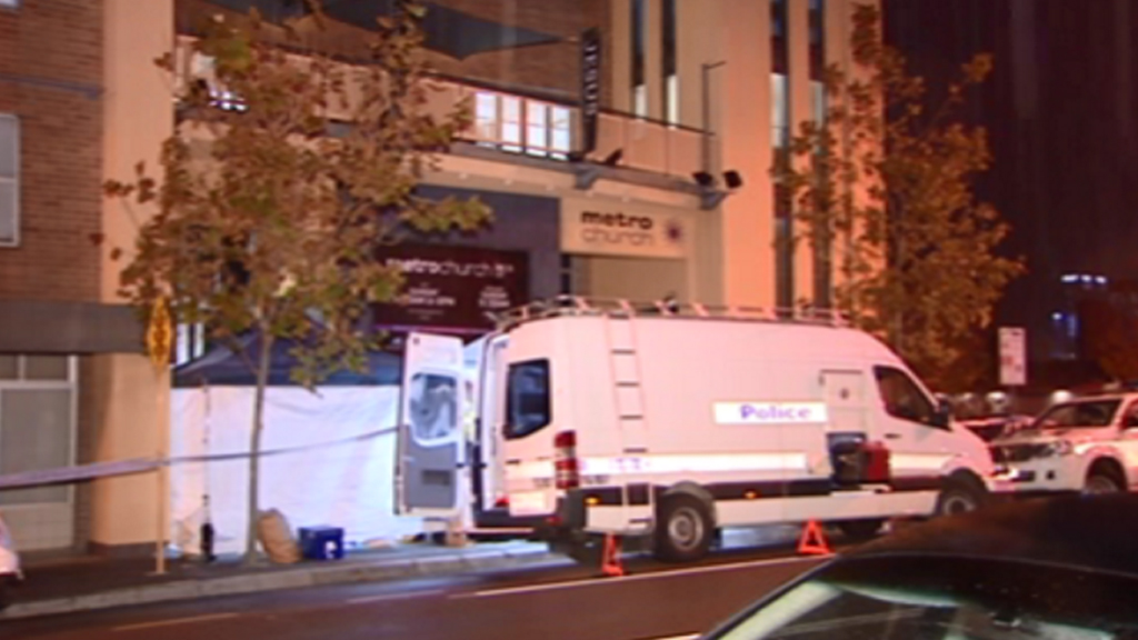 Police outside the Perth church. (9NEWS)