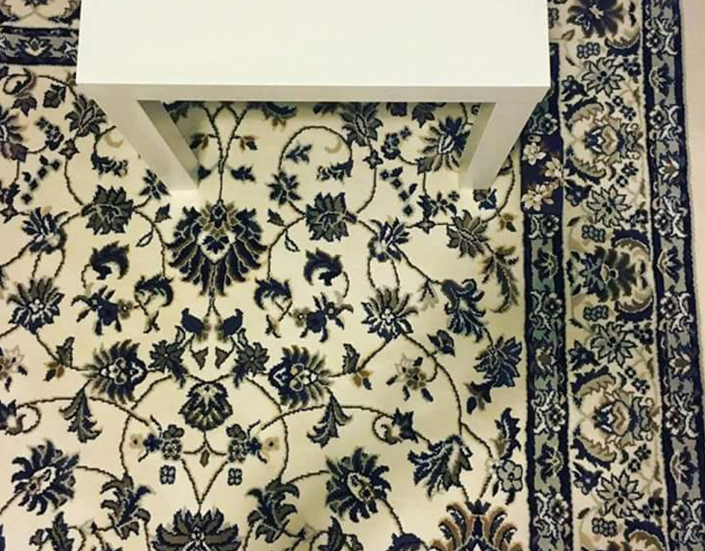 Can you spot the phone in this picture of a rug?
