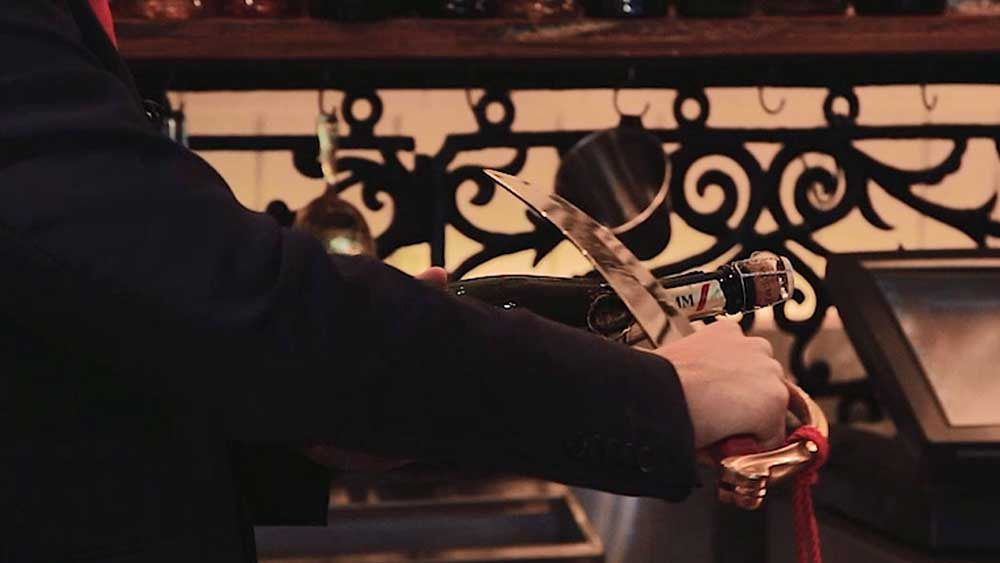 Champagne Ambassador Chris Sheehy demonstrates the art of the sabrage. Video: 9Kitchen
