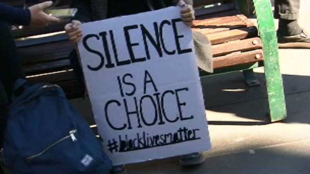 A sign at the rally at the State Library of Victoria. (9NEWS)