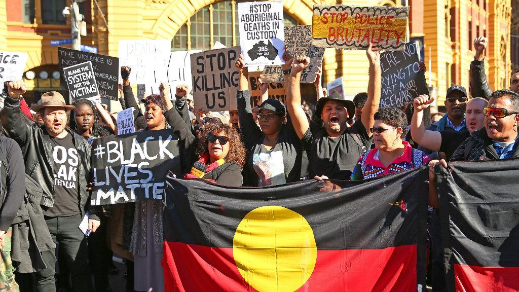 Demonstrators outside Flinders Street Station. (Getty)
