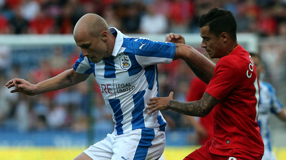 Aaron Mooy, left, holds off  Philippe Coutinho (Getty)
