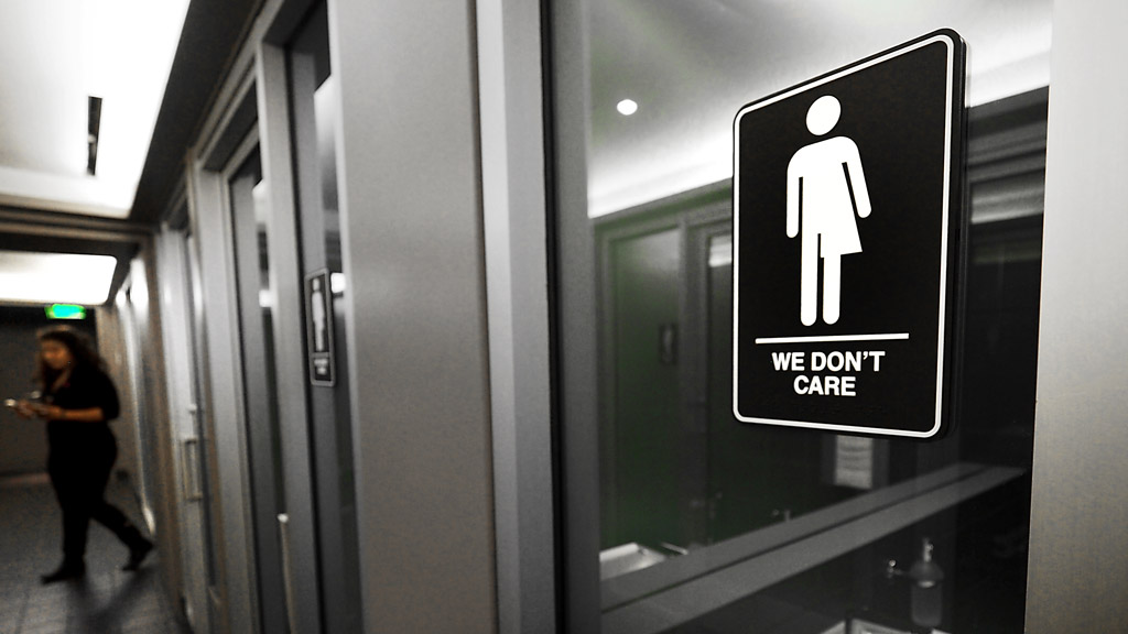 Gender neutral signs are posted in the 21C Museum Hotel public restrooms on May 10, 2016 in Durham, North Carolina. (AFP)