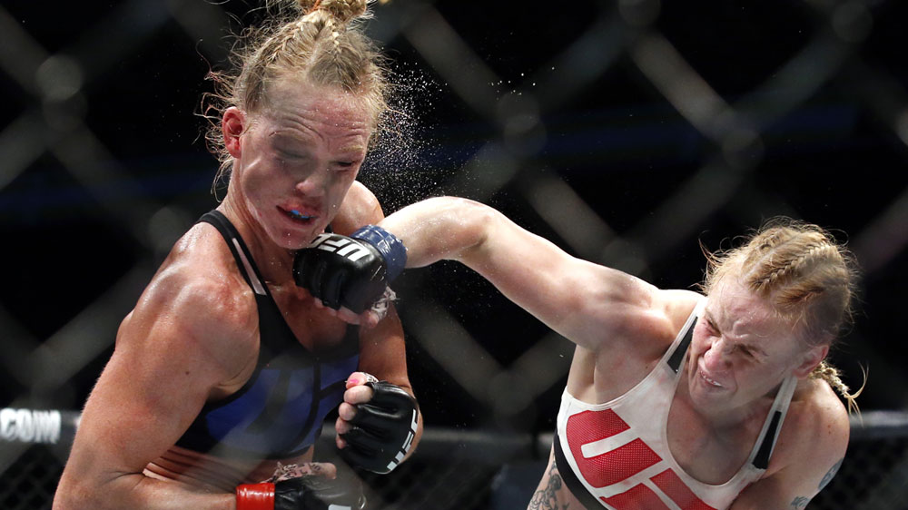 Valentina Shevchenko lands a big right on Holly Holm's chin (AAP)