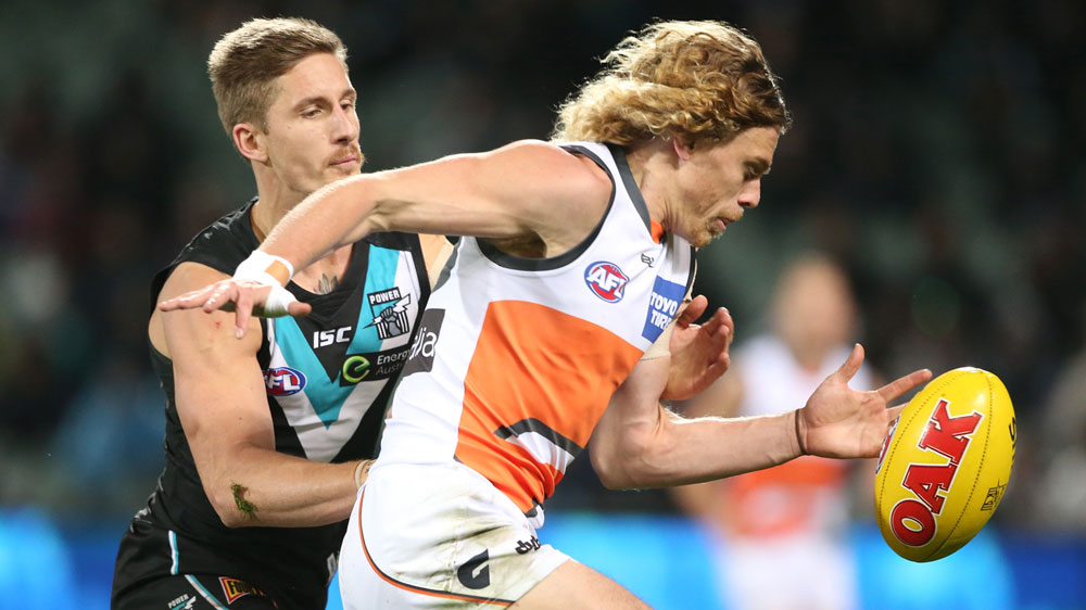 Giants Adam Kennedy with the ball (AAP)