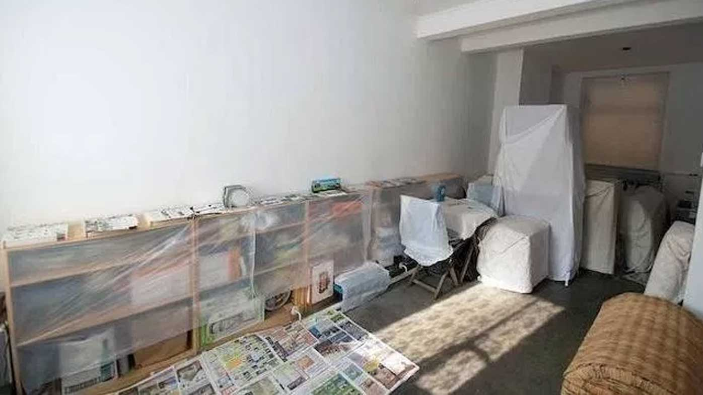 The plastic-covered furniture in Edward Tenniswood's home. (Zoopla)