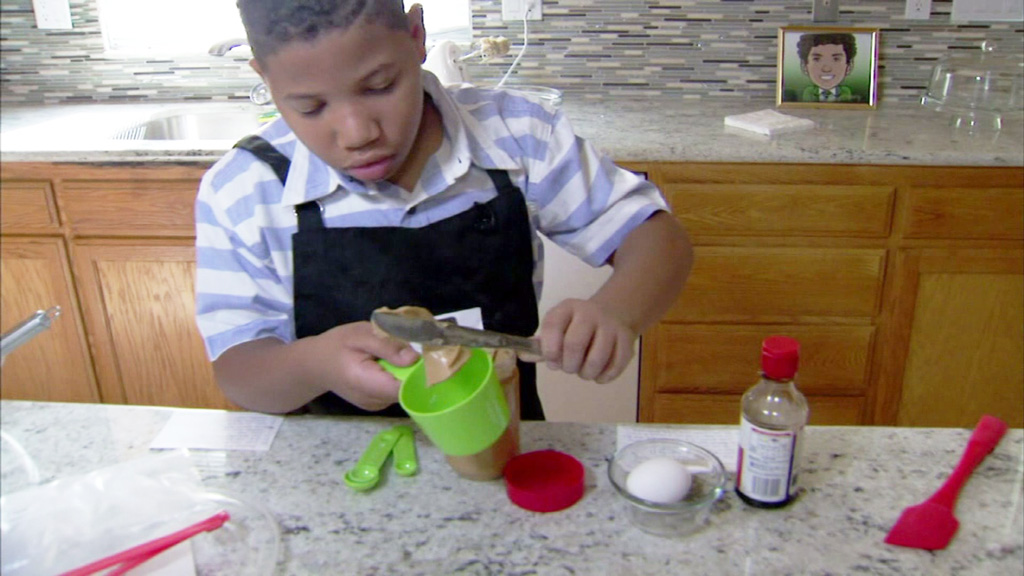 Eight-year-old boy opens own bakery in bid to buy mum a new home