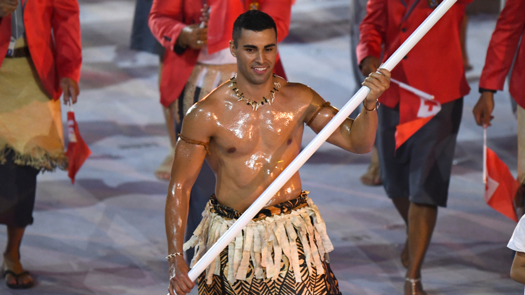 Tonga's flag bearer gets oiled up by presenters on US morning show