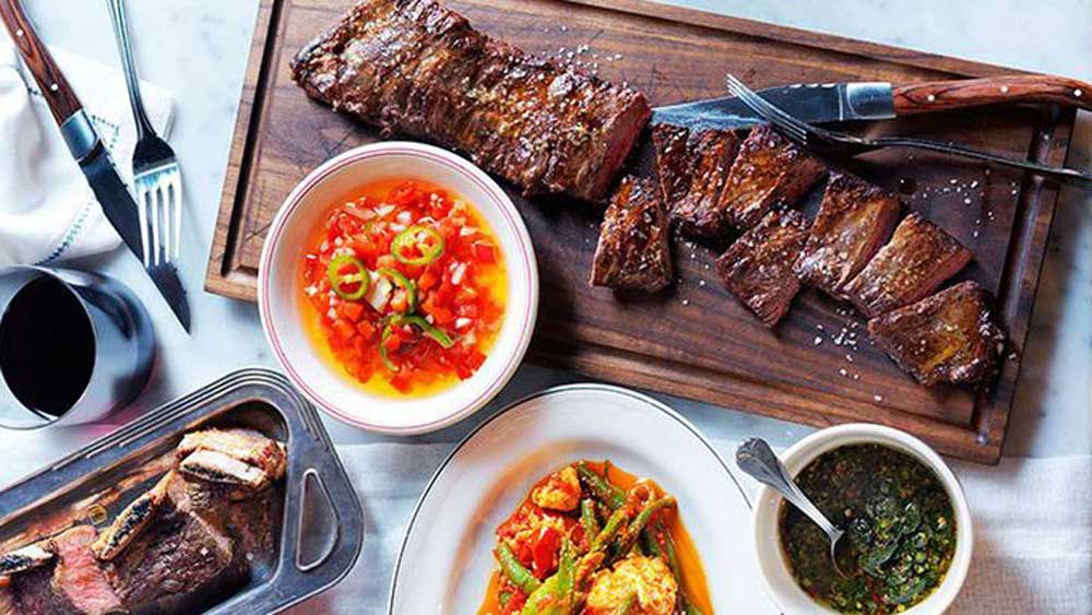 <strong>Char-grilled skirt steak and beef short ribs with salsa Criolla and chimichurri</strong>