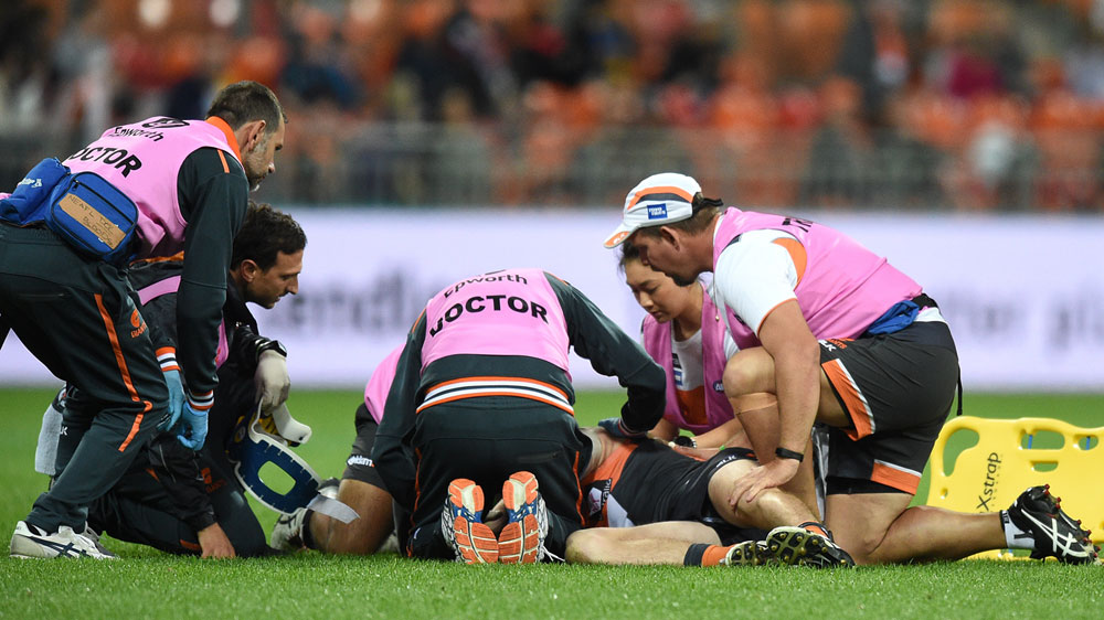 Kennedy carted off after sling tackle