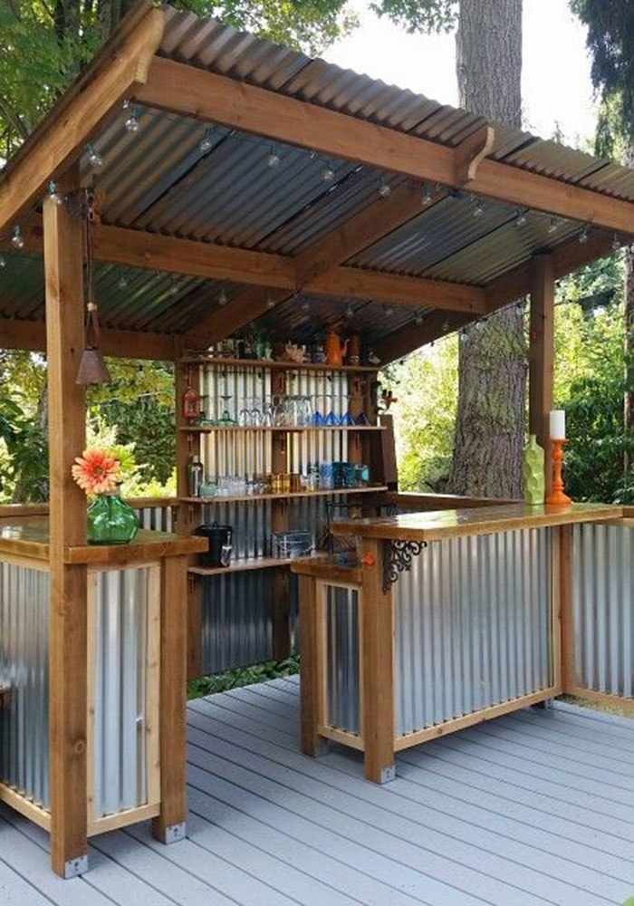 Five backyard bars you 39 ll want to build immediately for Garden shed bar