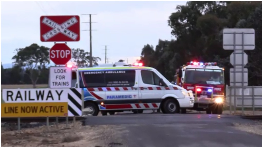 The man's car collided with the train on Power Station Road. (9NEWS)