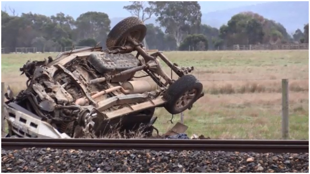 Man dies after car collided with train at Victorian crossing