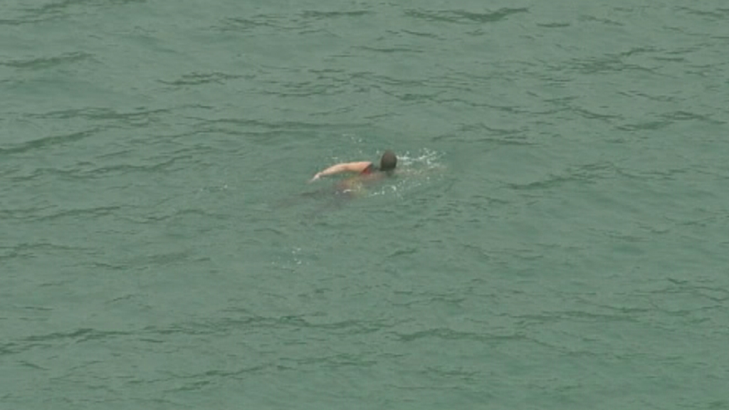 The man allegedly attempted to evade police by swimming away. (9NEWS)