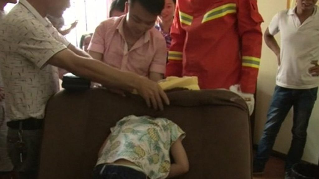 Firefighters use scissors to rescue boy who got his head stuck in a sofa
