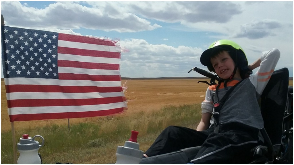 Patch is travelling across America on a tandem bike. (School of the Road)