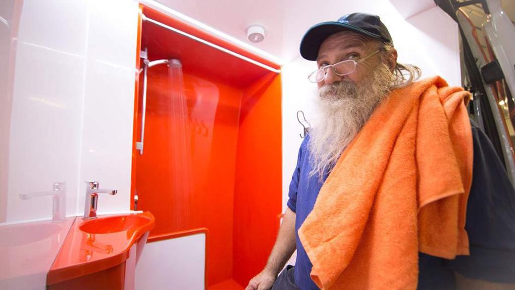 Brisbane homeless man Dave Brum enjoys the new shower facilities. (Orange Sky)