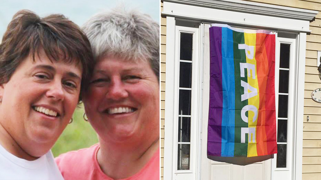 Neighbours display rainbow flags in solidarity with gay couple after homophobic attack