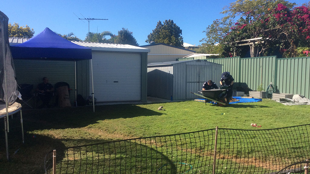 The backyard where police are conducting investigations into the homicide. (Queensland Police)