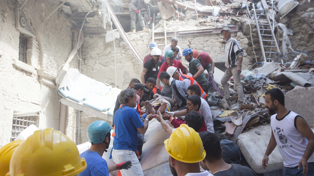 Rescue crews pull someone from the rubble. (AFP)