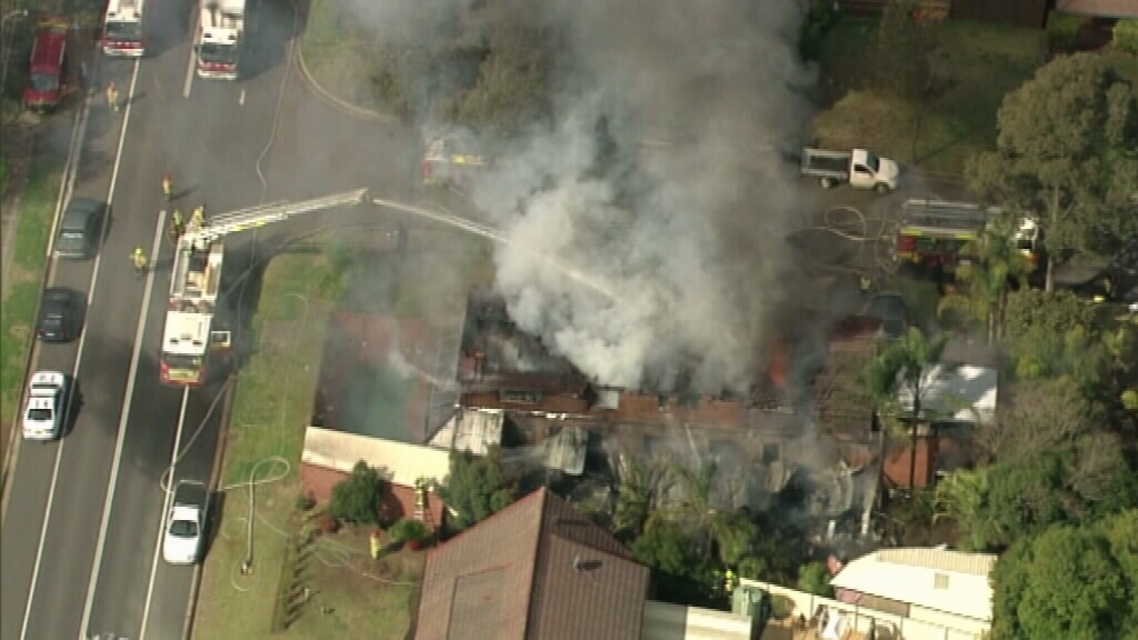 Fire crews battle the fire. (9NEWS)