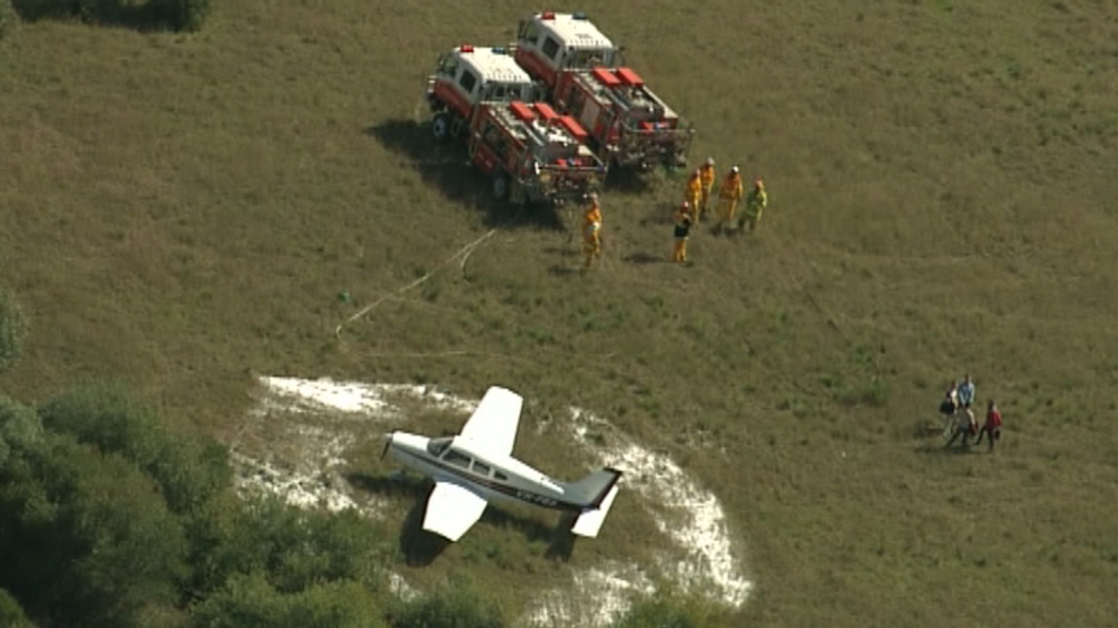 The plane was forced to make an emergency landing at around 12.30pm. (9NEWS)