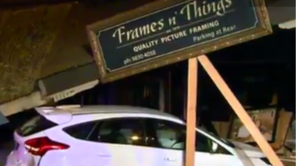 The store and the car sustained significant damage. (9NEWS)