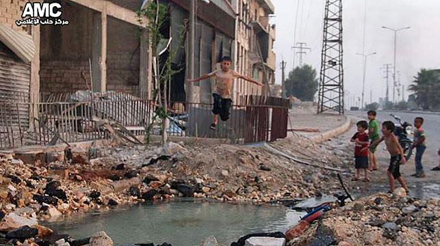Syrian boys swim in Aleppo crater as war rages around them
