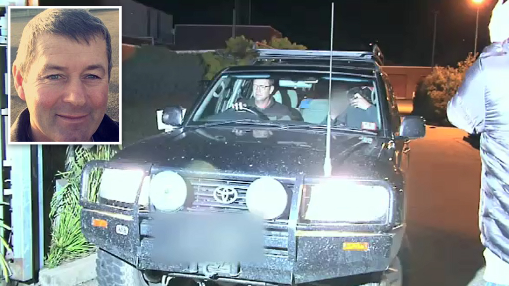 Mark Tromp made an obscene gesture as he was driven out of the Wangaratta police station. (9NEWS)