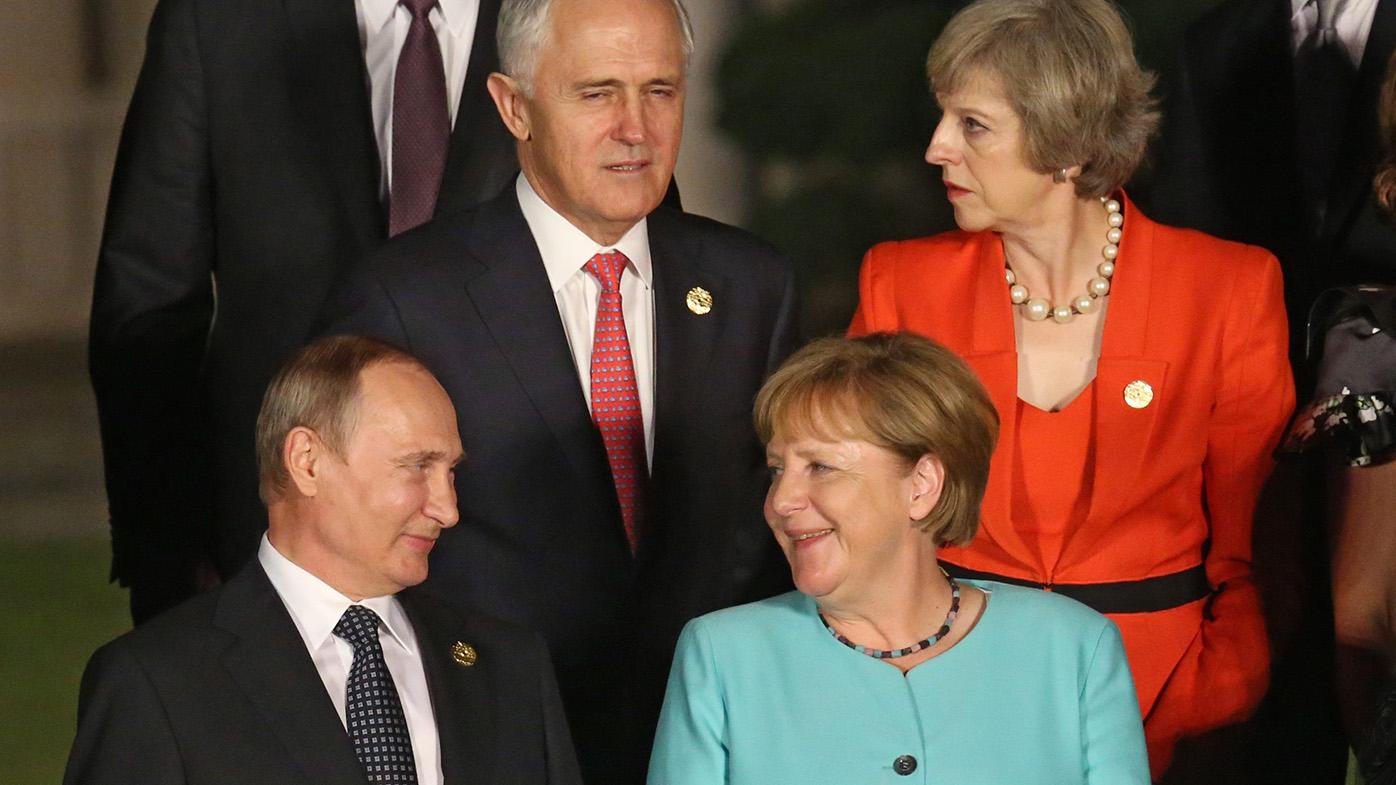 Russian President Vladimir Putin, German Chancellor Angela Merkel and Australian Prime Minister Malcolm Turnbull and British Prime Minister Theresa May. (AAP)