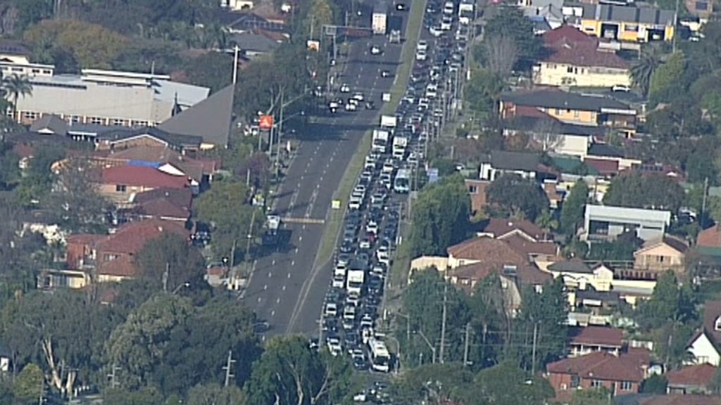Traffic backed up for 8km after water main bursts in Macquarie Park