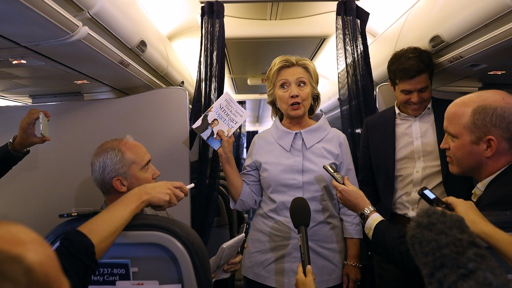 Mrs Clinton addressed the media on her official campaign plane. (Getty)