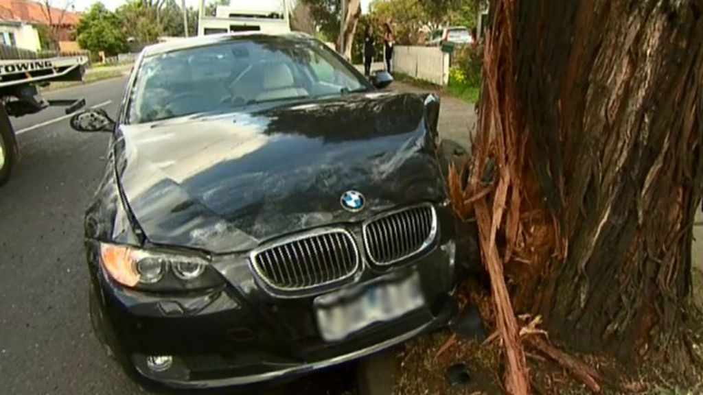 Three arrested, one man on the run after police car rammed in Coburg