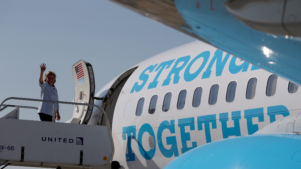 Democrat Hillary Clinton waves from her campaign plane. (Getty)