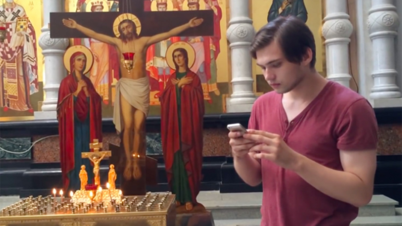 The Russian plays Pokemon Go in an Orthodox church. (YouTube)