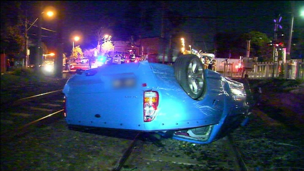 Teens crash car, flip onto tracks and collide with moving train in Ivanhoe