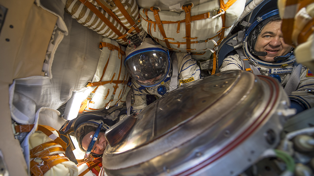 Astronauts Williams, left, and Russian cosmonauts Alexey Ovchinin, center, and Oleg Skripochka, of Roscosmos, inside the Soyuz TMA-20M after landing on Earth. (AAP)