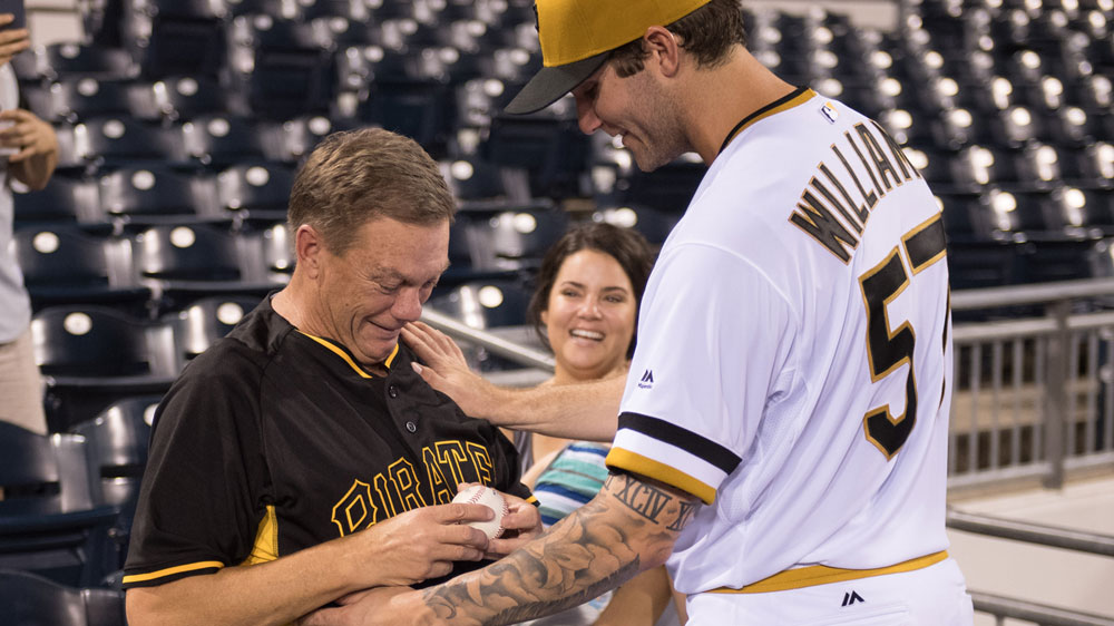 Trevor Williams (right) hands over the game ball to his dad (Getty)