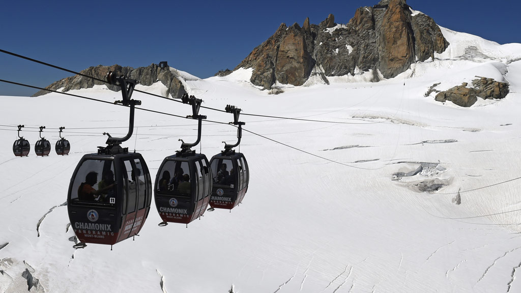Fifty people to remain trapped in cable cars suspended over French Alps overnight