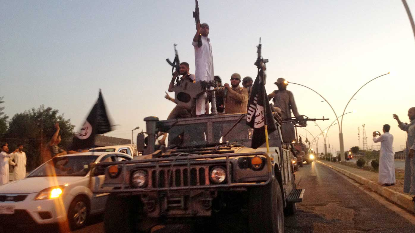 A 2014 photo of Islamic State forces in a commandeered Iraqi army truck in Mosul. (AP)