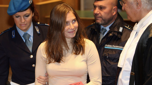 Knox smiles at her lawyer arriving at court in 2009. (AP)