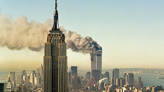 The twin towers of the World Trade Center burn behind the Empire State Building in New York, Tuesday, Sept. 11, 2001. (Andrew Knox/Facebook)