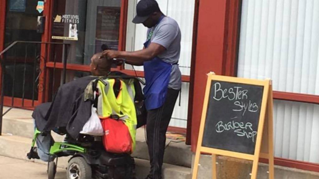 Barber cuts wheelchair-bound man's hair on a Massachusetts street