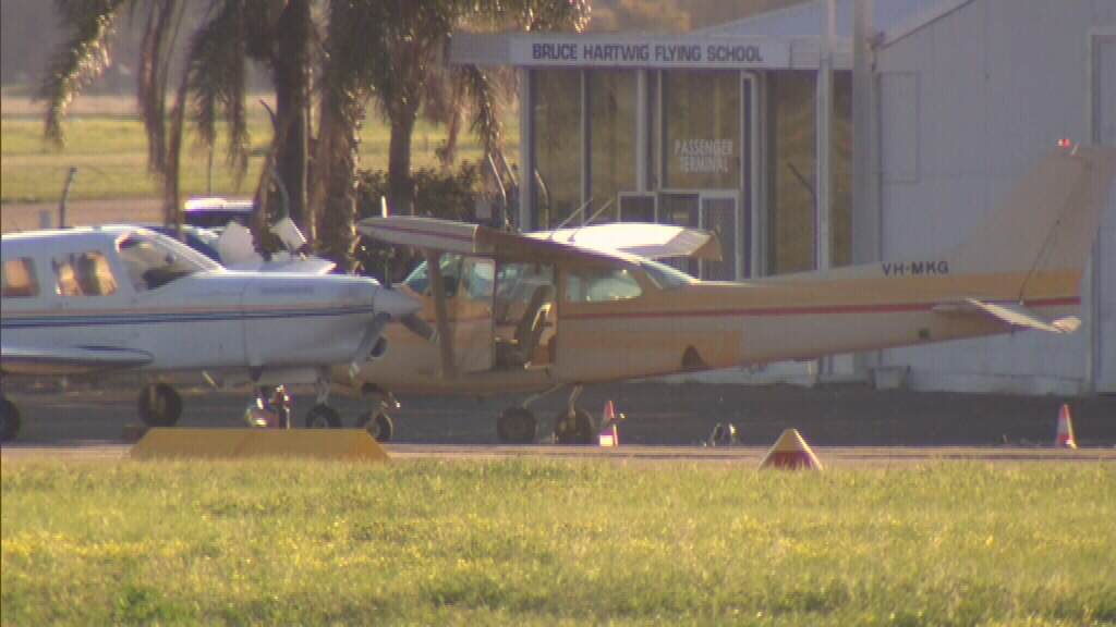 It is believed one plane rolled into a second. (9NEWS)