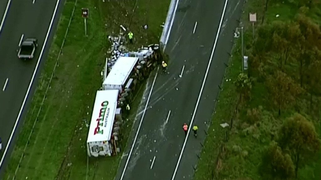 A truck has rolled on Sydney's Westlink M7. (9NEWS)