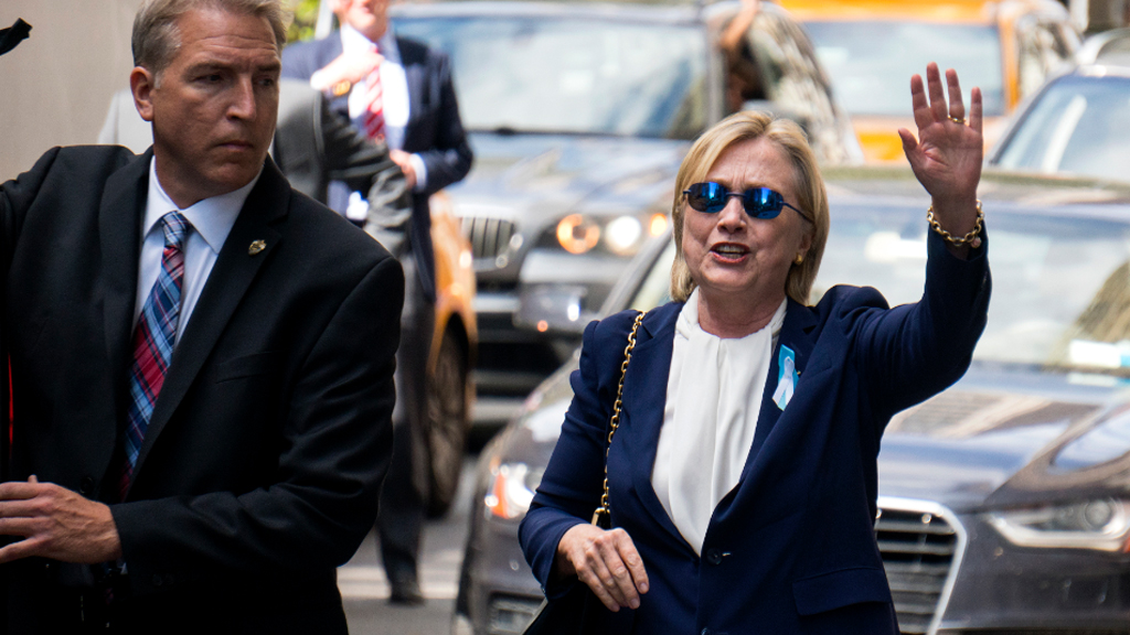 Hillary Clinton waved as she left her daughter's apartment. (AAP)