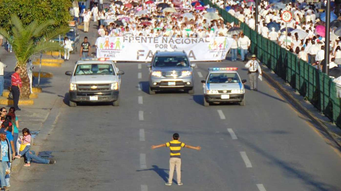Picture of 12-year-old boy standing up to anti-gay protestors goes viral