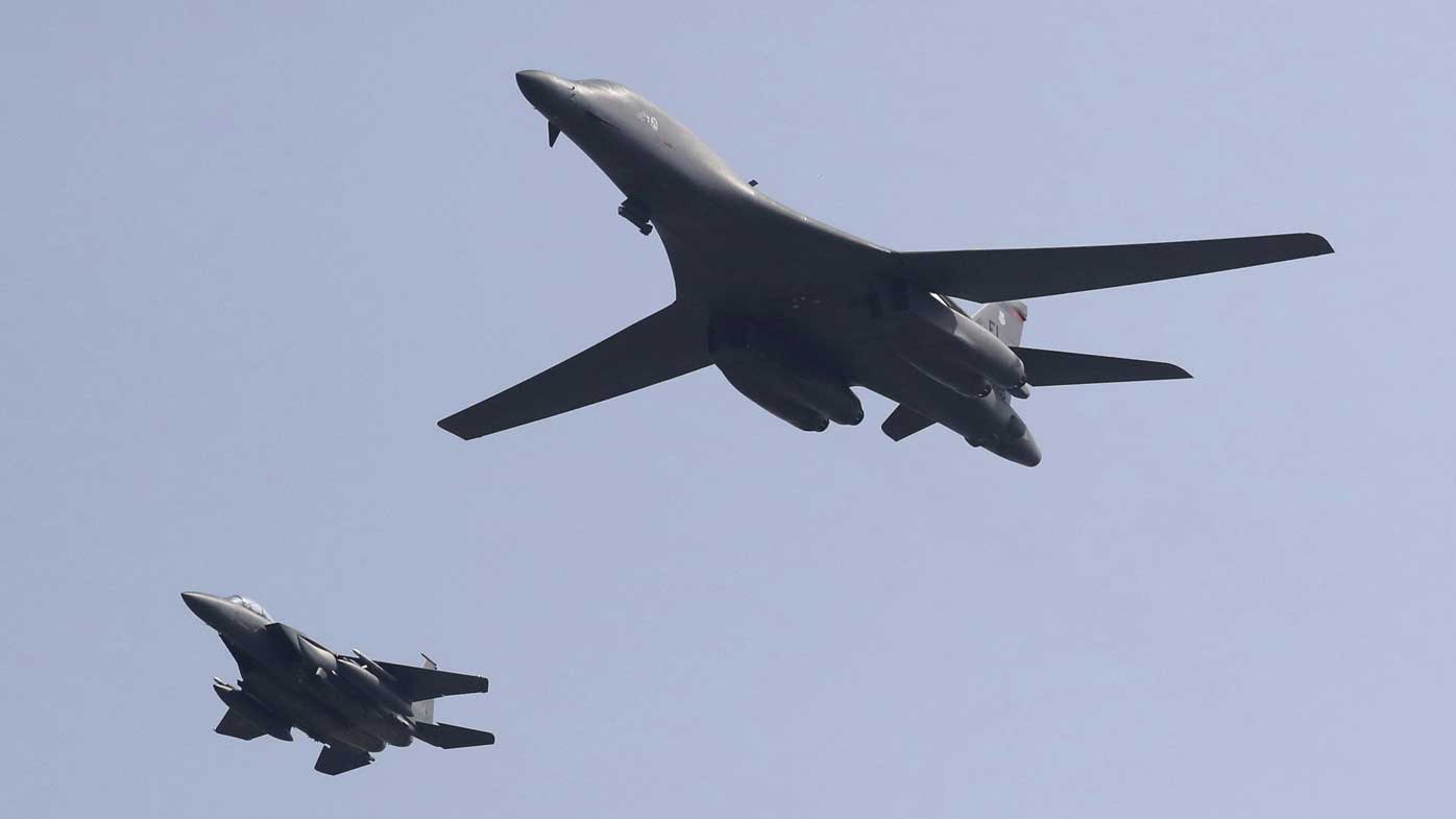 A B1 bomber accompanied by a South Korean fighter jet. (AP)