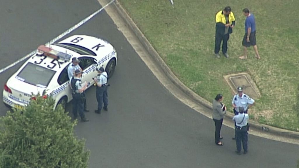 The woman's body was found inside a home on Links Avenue, Milperra. (9NEWS)