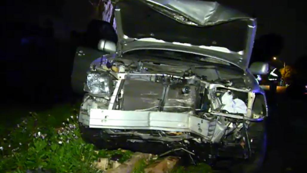 Woman wanted over stolen car crash into Melbourne property